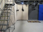 another view of the studio witj off-white curtains and a ladder