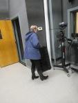 Karen Handville walking toward a studio camera